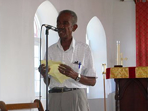Poley Dickenson inside St Johns Church - telling the history of the church and Salt Cay  - photo by Jim & Sharon Shaffer