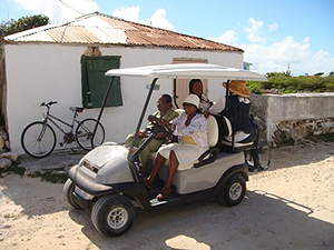 Salt Cay ladies traveling on down the road in a super powered golf cart  - photo by Jim & Sharon Shaffer