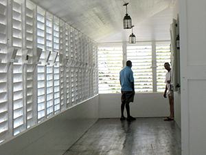 Restored porch with wooden shutters - Sunnyside - photo by Robin Savory