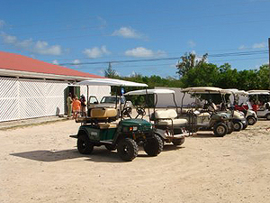 Transportation awaits the tour group outside the Salt Shed