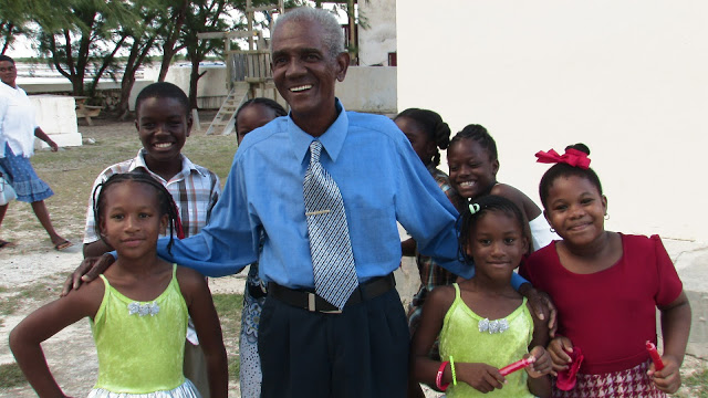 Mr Holton Dickenson catechist of St Johns the Divine on Salt Cay with the children of the community.